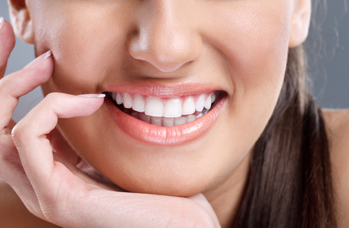 close up, beautiful young woman with big healthy smile